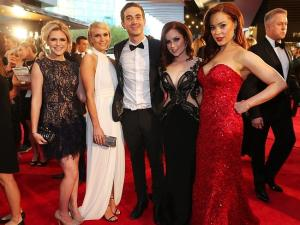 Gracie Gilbert (2nd from right) at the 2014 Logies in Pallas Couture