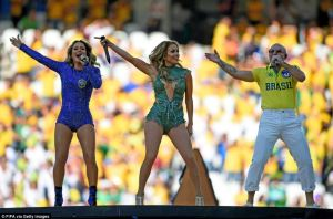 Jennifer Lopez alongside Pitbull and Claudia Leitte in a sparkly green custom-made Charbel Zoe Couture leotard during their performance at the 2014 World Cup Opening Ceremony