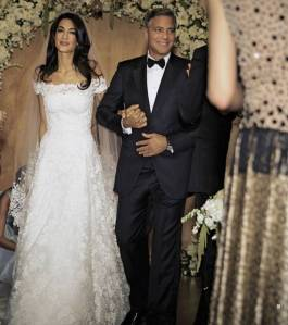 Amal Alamuddin with George Clooney in her custom-made Oscar de la Renta wedding gown