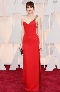 Dakota Johnson wearing Yves Saint Laurent at the 2015 Oscars